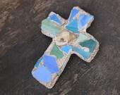 blue hues sandy beach cross