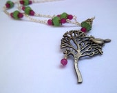 Bird in tree silver tone necklace with green and pink glass beads