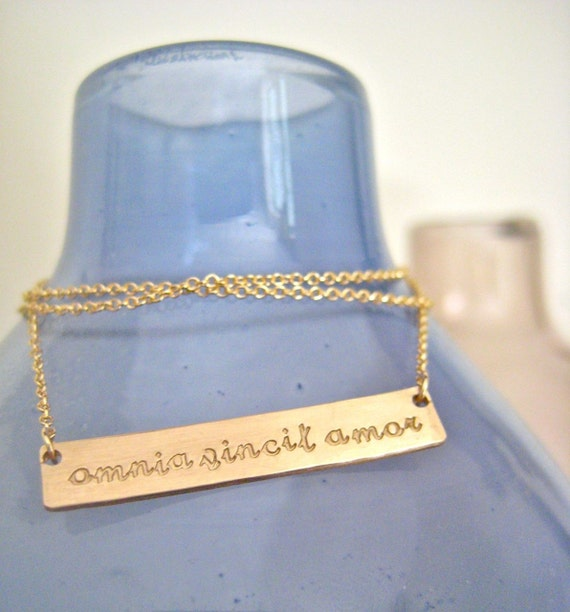 "Gold Bar Necklace Inspiring Quote- ""Love Conquers All"""