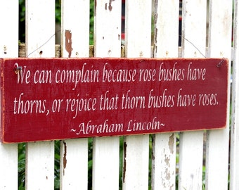 we can complain because rose bushes have thorns... Abe Lincoln Wooden Garden Sign