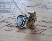 The embracing couple heart locket. FREE WORLDWIDE SHIPPING.