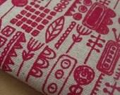 totem - hand screenprinted fabric in raspberry red on oatmeal