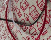avenue - hand screenprinted fabric in london bus red on oatmeal