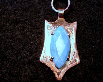 Copper pendant with faceted turquoise stone