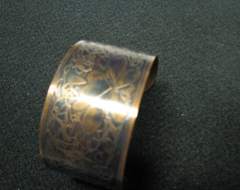 Copper cuff with heart shaped etching