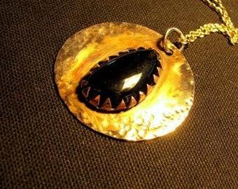 Copper pendant with onyx stone