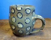 Wheel thrown stoneware mug in green celadon with lemon polka dots