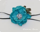 The Audrey turquoise aqua handmade fabric flower with feathers on a thin black elastic headband your choice of size