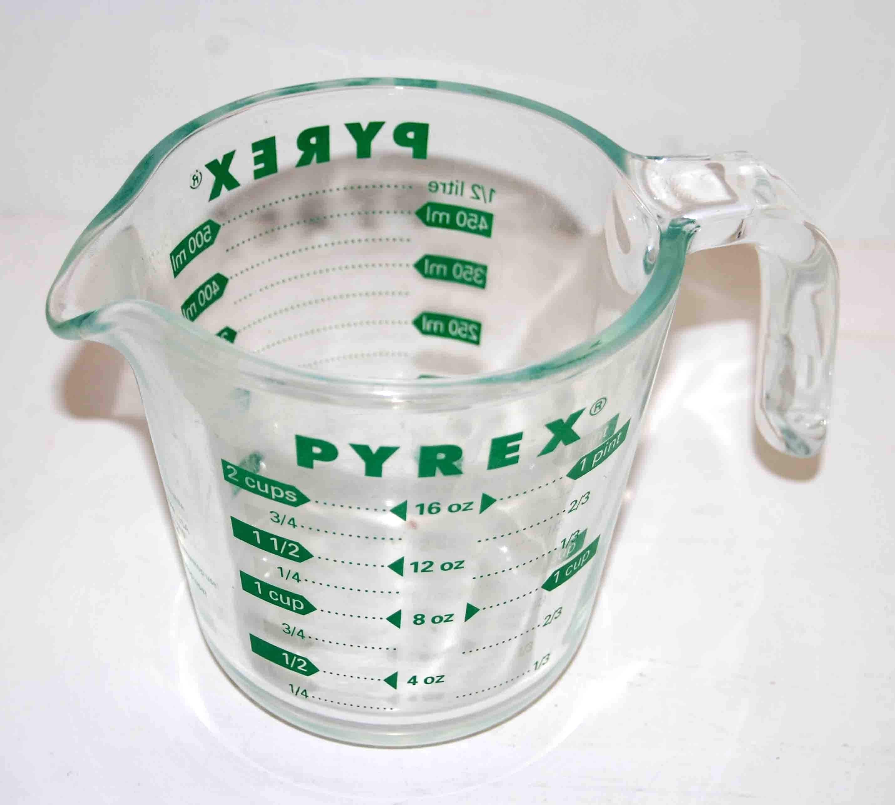 pyrex 16 oz measuring cup with green print. Black Bedroom Furniture Sets. Home Design Ideas