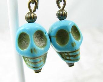Skull earrings on long brass ear wires, Turquoise Skulls, Blue Skull Earrings