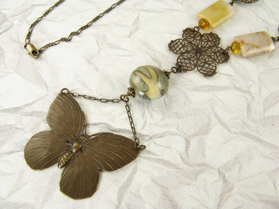 Long fine brass chain with gemstones, filigree flower, brown lampwork bead and brass butterfly necklace
