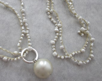Crocheted jewelry Pearl Drop: multistrand crocheted necklace in ivory white with large glass pearl pendant