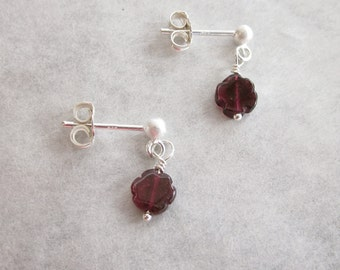Tiny Garnet Flower earrings dangle on sterling silver posts