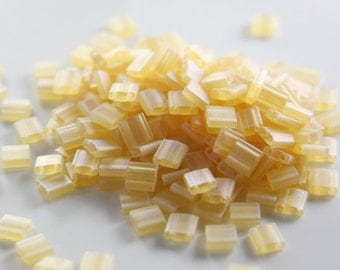 10 Grams Japanese Miyuki Tila Beads-Light Amber Transparent AB (TL0132FR)