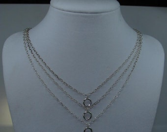 Sterling Silver 3 strand, 3 loop necklace.