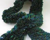 Knitted ruffle scarf in blue/green/brown