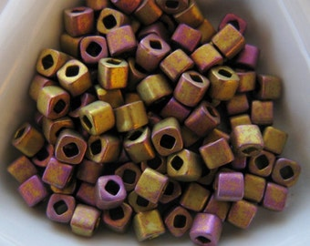 Toho 3mm Cube Beads, Matte Metallic Gold Iris, (color F460S) approx. 12 Grams