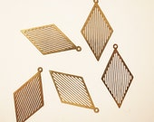 25 Newly made raw brass die cut metal geometric pop art charm in diamond shape gold tone lines 30mm long