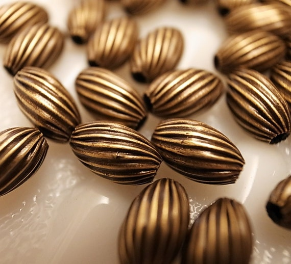 25 Vintage brass beads 10 mm crimp swirl texture with hole through antique brass plating