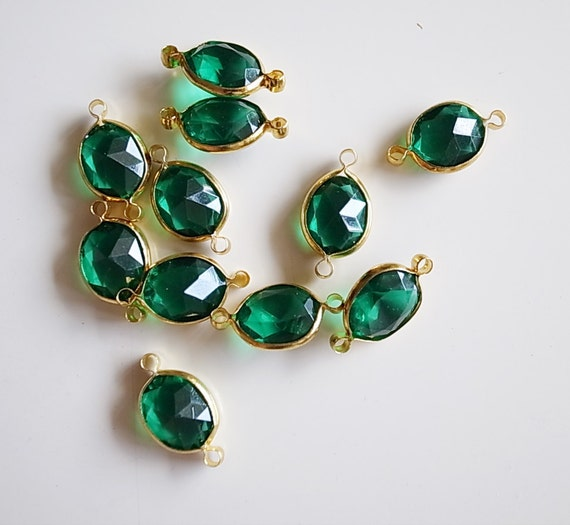 12 Vintage emerald green connector beads lucite with brass frame caged 16mm long with new plating on the metal gold tone