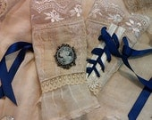 Custom made Victorian inspired lace and cameo arm cuffs with blue ribbons