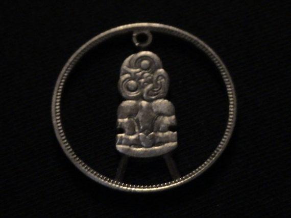 1963 New Zealand - cut coin pendant - w/ Hei Tiki