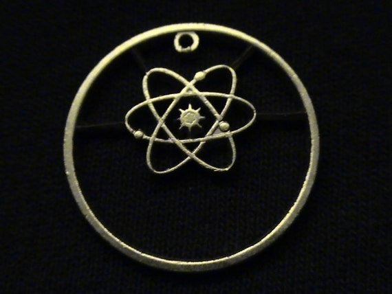 Greece - cut coin pendant - w/ the Atom, our favorite unit of matter.... 2002