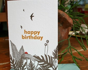 letterpress happy birthday woodland greeting card with ferns and birds and ladybug in red
