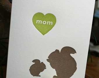 letterpress mothers day greeting card with mom squirrel and green heart with the words mom