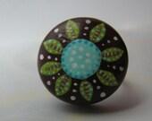 green flower on brown adjustable ring