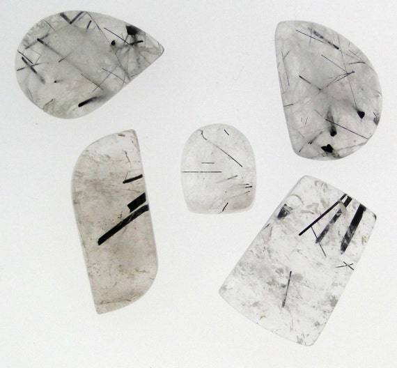 5 abstract shaped cabochons of Black Rutilated Quartz, 90 carats total weight         096-18-001