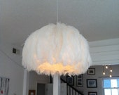 large ostrich chandelier with brass canopy