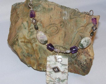Wire wrapped peace jade or peace jasper and amethyst necklace with silver accents