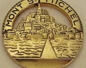 MONT St MICHEL CHATEAU France  Souvenir Pendant Goldtone cast metal 1  in diam