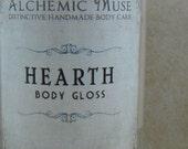 Hearth - Body Gloss - Oat Porridge, Winter Citrus, Crackling Firewood
