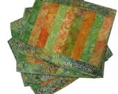 Placemats Quilted in Orange and Green Batik