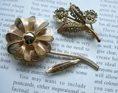 Two Vintage Gold Floral Brooches