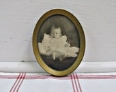 Gawking Baby Picture ...vintage tin oval frame