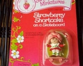 Vintage Strawberry Shortcake Figure - Strawberry Shortcake on a Skateboard