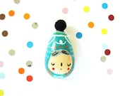 hand painted wooden brooch with pom pon turquoise white Ovo