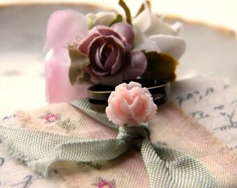 Creme Fraise.  pale pink rose on antiqued brass adjustable band