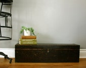 a very long vintage wood crate with lid.