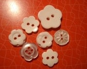 7 random white FLOWER shaped buttons