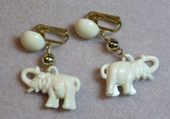 Vintage Elephant Earrings - Creamy White plastic charms on gold tone HONG KONG marked clip ons with matching cabs