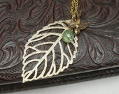 Lima - large gold filigree leaf, swooping swallow, and crystal teardrop NECKLACE