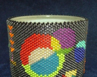 Handmade Beadwork, lifestyle. Flower Power Tealight Holder