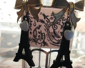 Black Effiel Tower bow earrings with pearl hearts