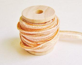Sweet Peach pearl herringbone ribbon trim on a wood spool -5 yards