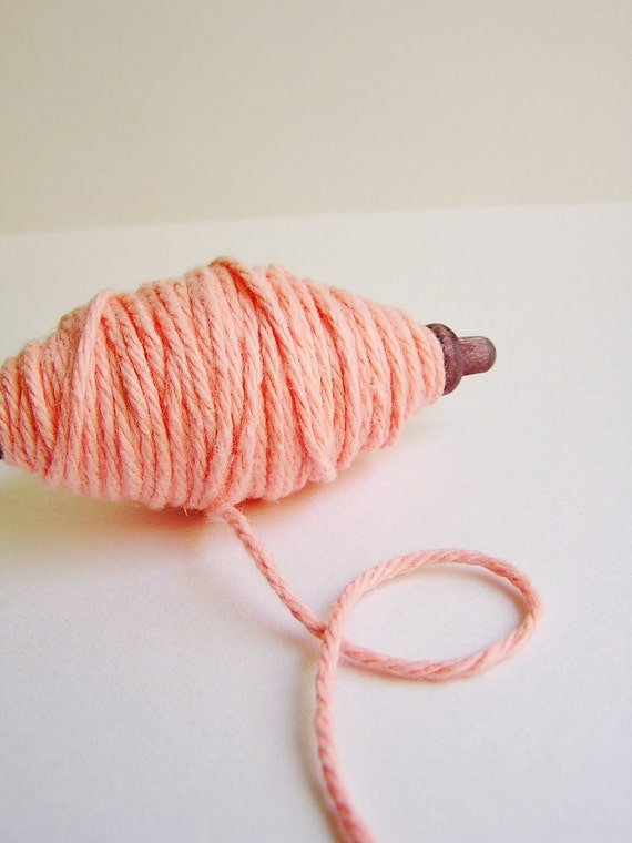 Blush thick cotton twine on a chocolate spindle