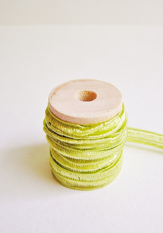 Pistachio green pearl herringbone ribbon trim on a wood spool -5 yards